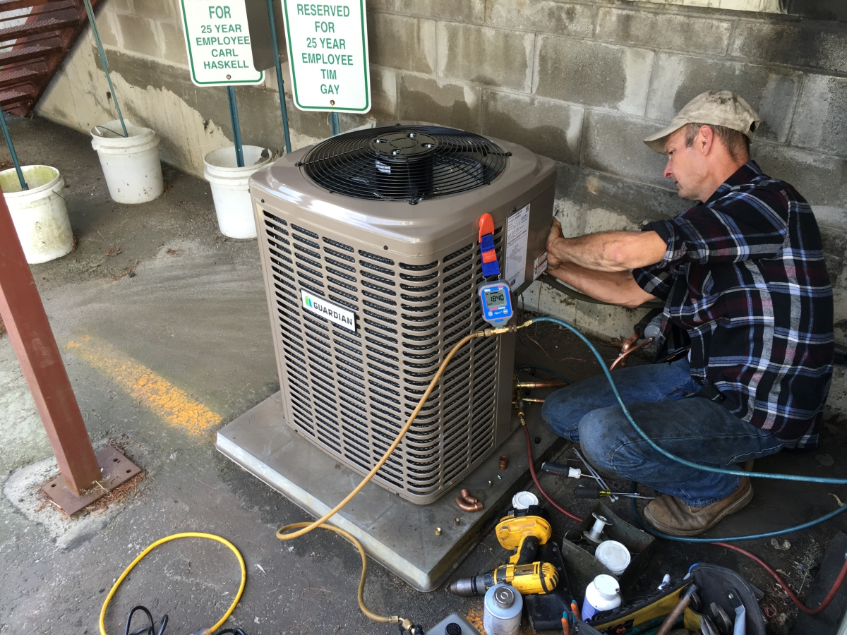 HPA Service Tech working on a Air Conditioning unit